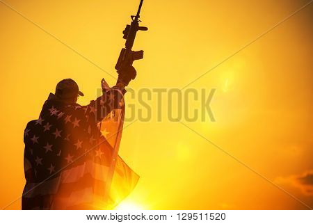 The American Victory. Army Troop with Assault Rifle Covered by American Flag. American Patriot