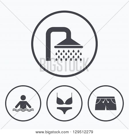 Swimming pool icons. Shower water drops and swimwear symbols. Human stands in sea waves sign. Trunks and women underwear. Icons in circles.