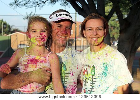 Rustenburg Marathon Club Rainbow Run - NOVEMBER 25: Lovely family covered in powder paint posing for picture on November 25 2015 Rustenburg South Africa.
