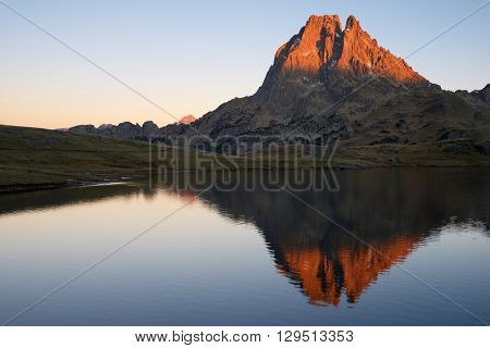 Midi Dossau Peak reflected in Ayous lake. Ossau Valley, Pyrenees National Park, Pyrenees, France.