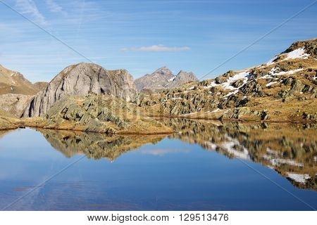 Peaks reflected in a lake. Ossau Valley, Pyrenees National Park, Pyrenees, France.