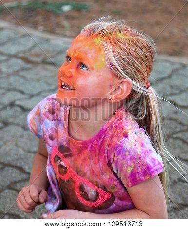 Rustenburg Marathon Club Rainbow Run - NOVEMBER 25: Beautiful young blond girl covered with powder paint at colour run on November 25 2015 Rustenburg South Africa.