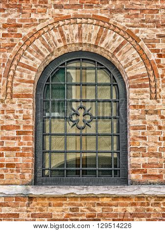Decorated arched windows of a medieval palace.