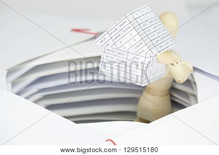 Wooden Dummy Holding House Have Surrounded By Overload Of Paperwork