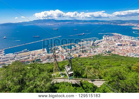 Cable car close to the top of Gibraltar Rock, located in the Upper Rock Natural Reserve, and the spectacular panoramic views of the city. United Kingdom, South West Europe.