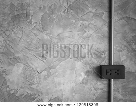 Outlet and Steel Pipe Electric Wire on Loft Style Wall Background with Copy Space Black and White Tone Minimalist Style