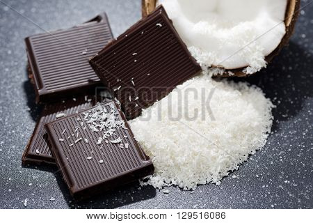 Dark chocolate and coconut desiccated on a old table