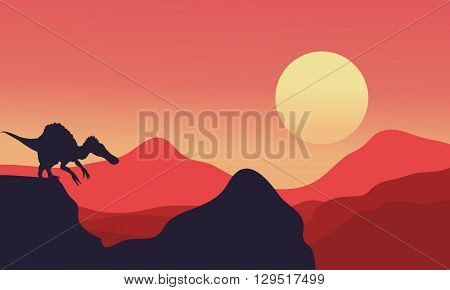 Silhouette of spinosaurus with red backgrounds at the afternoon