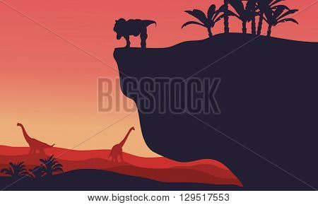 Silhouette of Brachiosaurus and T-Rex with red backgrounds at morning