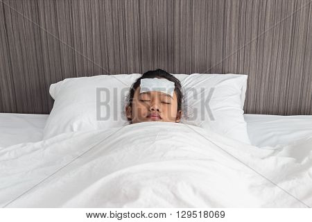 Children With Cool Fever On Forehead And Sleeping On The Bed