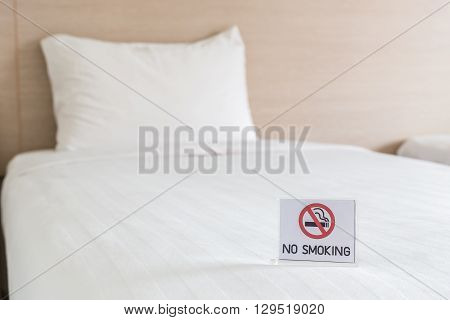 No Smoking Sign On The Bed In Hotel Room
