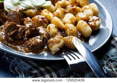 Italian Potato Dumplings With Stew And Cucumber Salad
