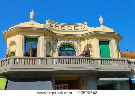 Viareggio Italy - June 28 2015: Stone balcony with decorative plants. Viareggio is the famous resort on the coast of the Ligurian Sea. Province Lucca Tuscany region of Italy