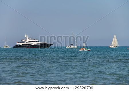 Viareggio Italy - June 28 2015: Sailing boats in Ligurian Sea. Viareggio is the famous resort and tourist centre of Tuscany region