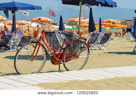 Viareggio Italy - June 28 2015: Parked bicycle on the beach. Viareggio is the famous resort on the coast of the Ligurian Sea