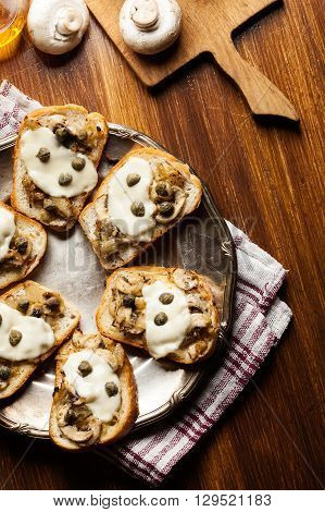 Crostini With Fried Mushrooms, Onion And Mozzarella Cheese