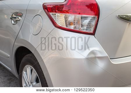 Backside Of Silver Car Get Damaged By Accident