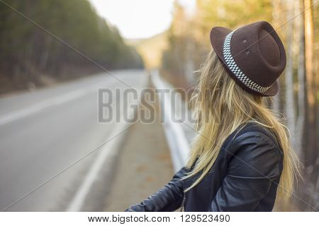 Beautiful young girl hitchhiking in the United States and Canada.