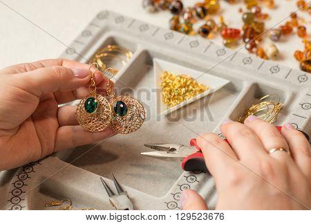 handcrafting a pair of beautiful bijouterie earrings