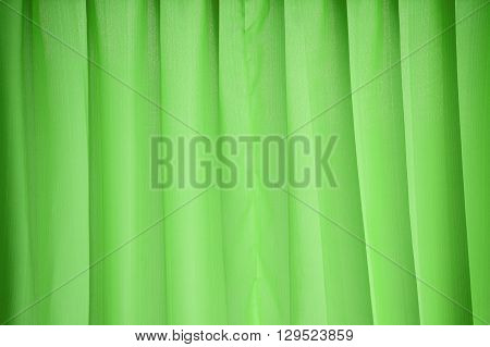 close up green curtain or drapery background