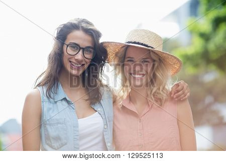 Portrait of young women embracing each other