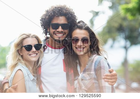 Group of friends in sunglasses posing at camera