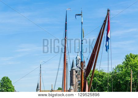 Various Sailboat masts with Dutch flags on top of the mast.