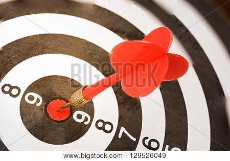 dart board with darts arrow in the target center.(Success business concept)