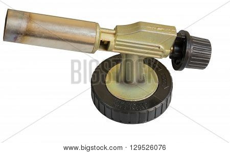 Side view on a small burner with a regulator. Isolated background.