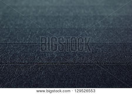 Abstract textured minimalist deep blue background with horizontal lines. The texture.