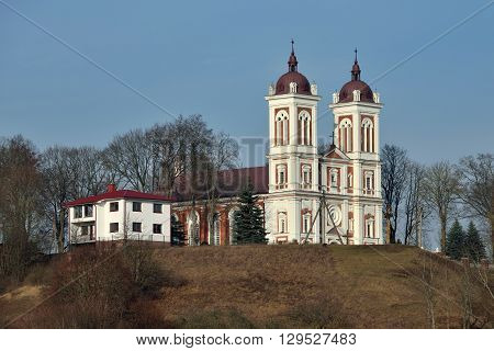 Church of St John the Baptist with the town of Seredzius Lithuania.