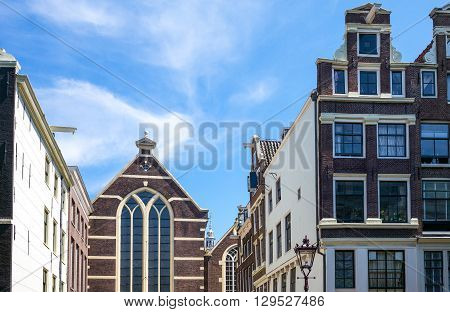 Amsterdam traditional buildings and a church in Red Light district.