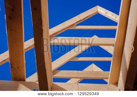view of a wooden house construction site