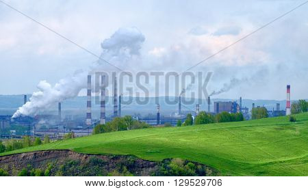 Metallurgical plant in Siberia. Ecology disaster concept.