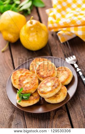 fried curd cheese cottage fritters pancakes on plate