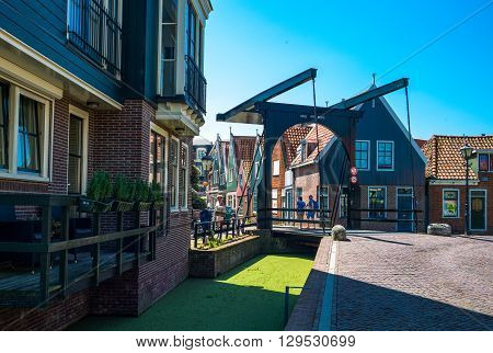 Volendam Holland - July 24 2014: Waterland district a drawbridge in the town center