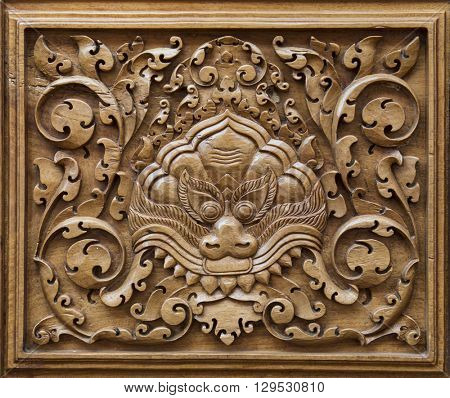 Vintage wood carved ornament in a ancient building in Cambodia