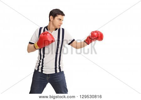 Young angry man with red boxing gloves isolated on white background
