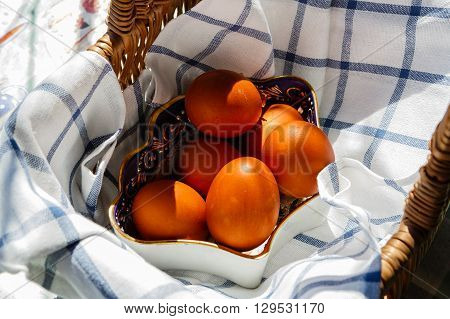 Painted Easter eggs in a basket prepared for consecration in orthodox church