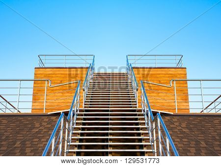 Stairs to the tribune or podium on a background of blue sky.