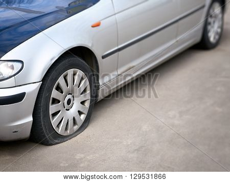 flat tire of the car on the road