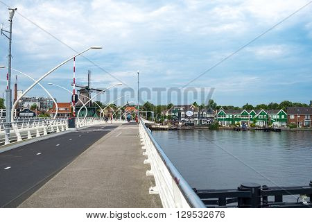 Zaandam Holland - July 25 2014: Waterland district a modern bridge in the famous area of the mills