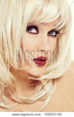 Vintage style portrait of young beautiful sexy blonde woman with stylish make-up