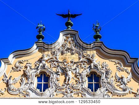 Wuerzburg- the Haus zum Falken -next to the Marienkapelle- with the original curved gables is one of the most beautiful rococo facades throughout southern Germany.