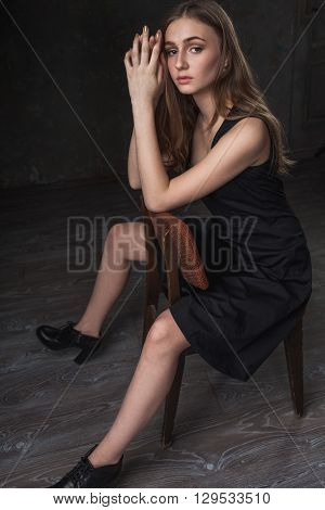 portrait of a girl with sad eyes over dark background
