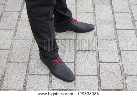 Close up image of man with a red shoe lace.