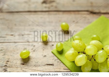 White wine grapes on a old wooden table copyspace for own text
