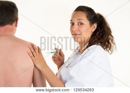 Doctor Getting Ready To Inject Patient With Sterile Syringe