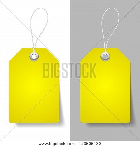 Blank yellow price tags on white and grey background