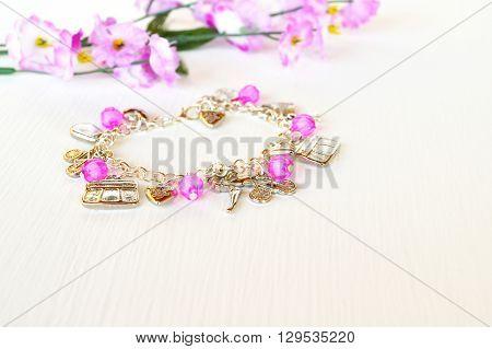 Fashionable beautiful bracelet with metal pendant. A beautiful accessory